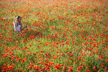 Germany, Bavaria, girl in a poppy field - YRF000081