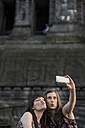 Germany, Koblenz, Deutsches Eck, playful tourists taking selfie at Emperor-Wilhelm monument - PAF001422