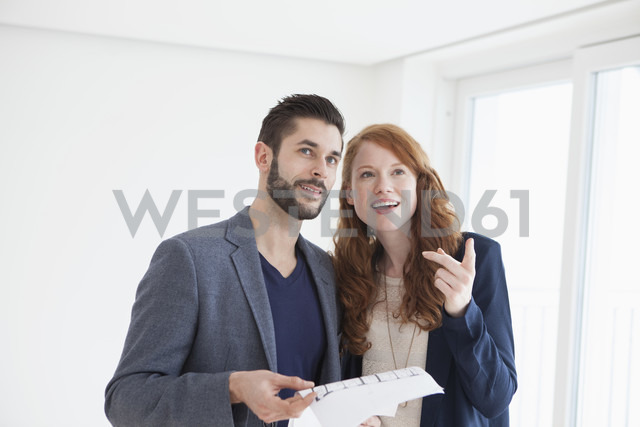 Young couple viewing new flat - RBF002810