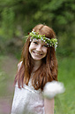 Portrait of smiling girl wearing floral wreath - LBF001123