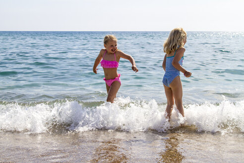 Greece, Corfu, Agios Georgios, two little girls bathing - JFEF000681