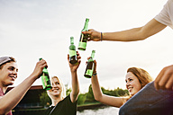 Friends drinking beer together at the waterside - GCF000081