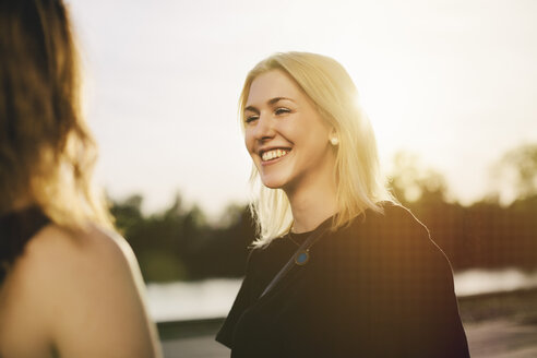 Smiling blond woman looking at her friend - GCF000092