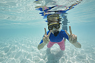 Maldives, happy woman snorkeling in the Indian Ocean - STKF001285