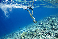 Maldives, woman snorkeling in the Indian Ocean - STKF001292