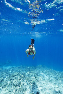 Maldives, woman snorkeling in the Indian Ocean - STKF001294