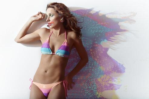 Surprised woman, splashed, colours, bikini - MHC000017