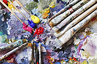 Paintbrushes and fresh paint on artist's palette - JTF000673