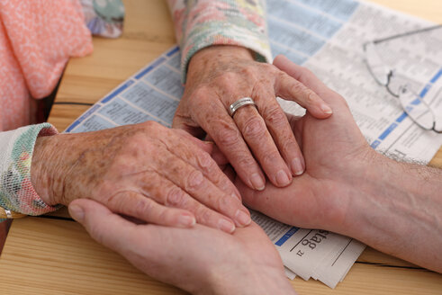Hands of senior woman holding man's hands - LBF001124