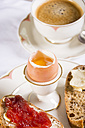 Breakfast table with black coffee, boiled egg and bread with jam - JUNF000312