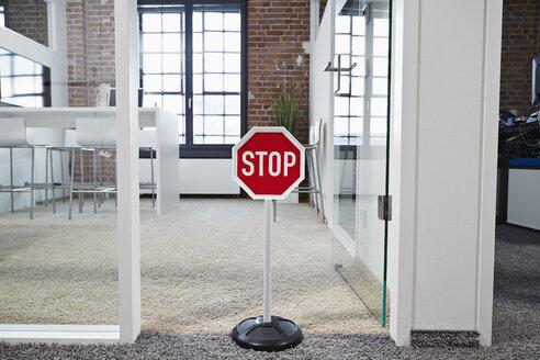 Stop sign in modern open plan office - PDF001061