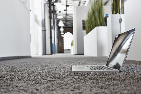 Laptop on carpet in office - PDF001067