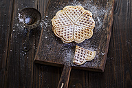 Waffles sprinkled with icing sugar on wooden board - SBDF002020