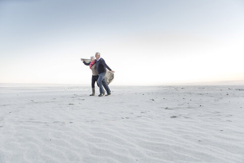 South Africa, Cape Town, senior couple walking on the beach - ZEF005675