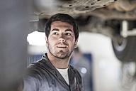 Car mechanic at work in repair garage - ZEF005689