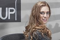 Portrait of smiling shop assistant - ZEF006658