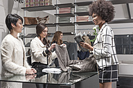 Woman shopping in luxury boutique - ZEF006665