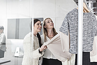 Two women shopping for clothes - ZEF006689