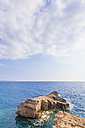 Greece, Aegean Islands, Rhodes, young man looking to rocky island - WDF003135