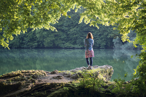 Germany, Bavaria, back view of a woman standing at a lake - MW000091