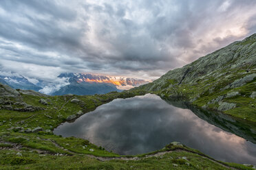 France, Mont Blanc, Lake Cheserys, Mont Blanc reflected in the lake in a stormy day at sunset - LOMF000001