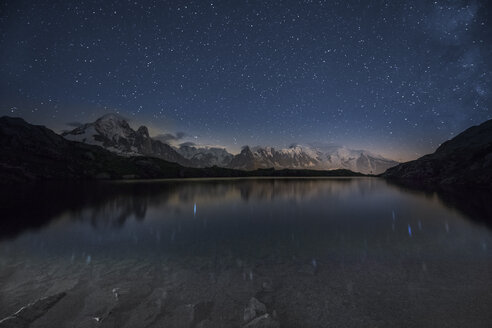 France, Mont Blanc, Lake Cheserys, Milky way and Mont Blanc reflected in the lake by night - LOM000008