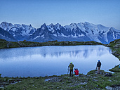 France, Mont Blanc, Lake Cheserys, photographers on the shore of the lake at sunrise - LOM000014