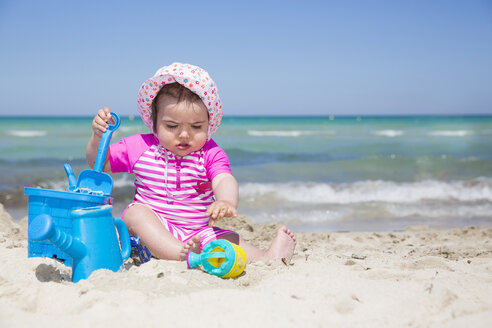 Spain, Majorca, baby girl playing on the beach - ROMF000063