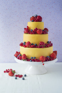 Fancy cake coated with fondant decorated with different berries - MYF001054