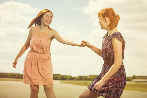 Two young women having fun together - TAM000155