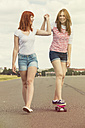 Two young women with skateboard - TAM000157