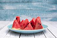 Chopped watermelon on blue plate - SARF001977
