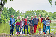 Germany, Happy children smiling at canera - MJF001576