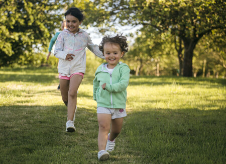 Running girls on a meadow - MGOF000311