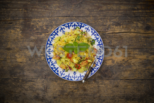 Plate of couscous salad on wood - LVF003597