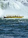 Switzerland, Rhine fall near Schaffhausen, Tourists in boat - KRP001493