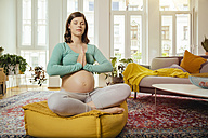 Pregnant woman meditating at home - MFF001670