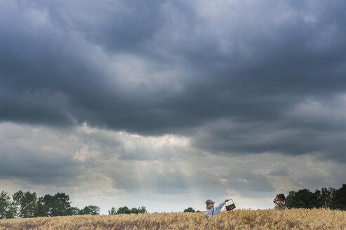 Germany, Saxony, two children standing in a grain field - MJF001590
