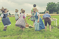 Germany, Saxony, children in traditonal clothes dancing on a meadow - MJF001629