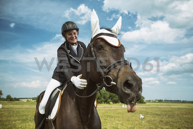 Smiling rider on horse - TAMF000236