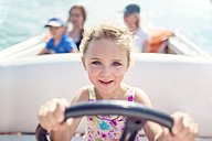 Portrait of little girl at steering wheel of a boat - MW000092
