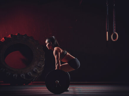 Young woman with barbell - MADF000328