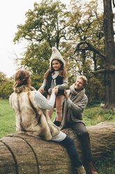 Happy family spending time together in an autumnal park - CHAF000234