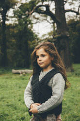 Portrait of little girl standing in an autumnal park - CHAF000246