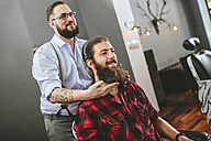 Man with full beard at the barber - MADF000336