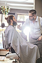 Barber cutting beard of a customer - MADF000348