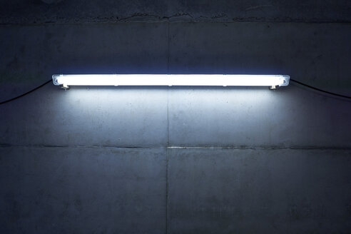 Neon light at concrete wall - FMKF001571