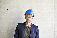 Portrait of confident architect on construction site - FMKF001643