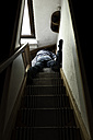 Corpse of man lying on staircase - MID000478
