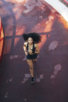 Spain, Barcelona, jogging young woman - EBSF000721